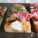 Pizza con zucchine marinate, galaverna e prosciutto crudo