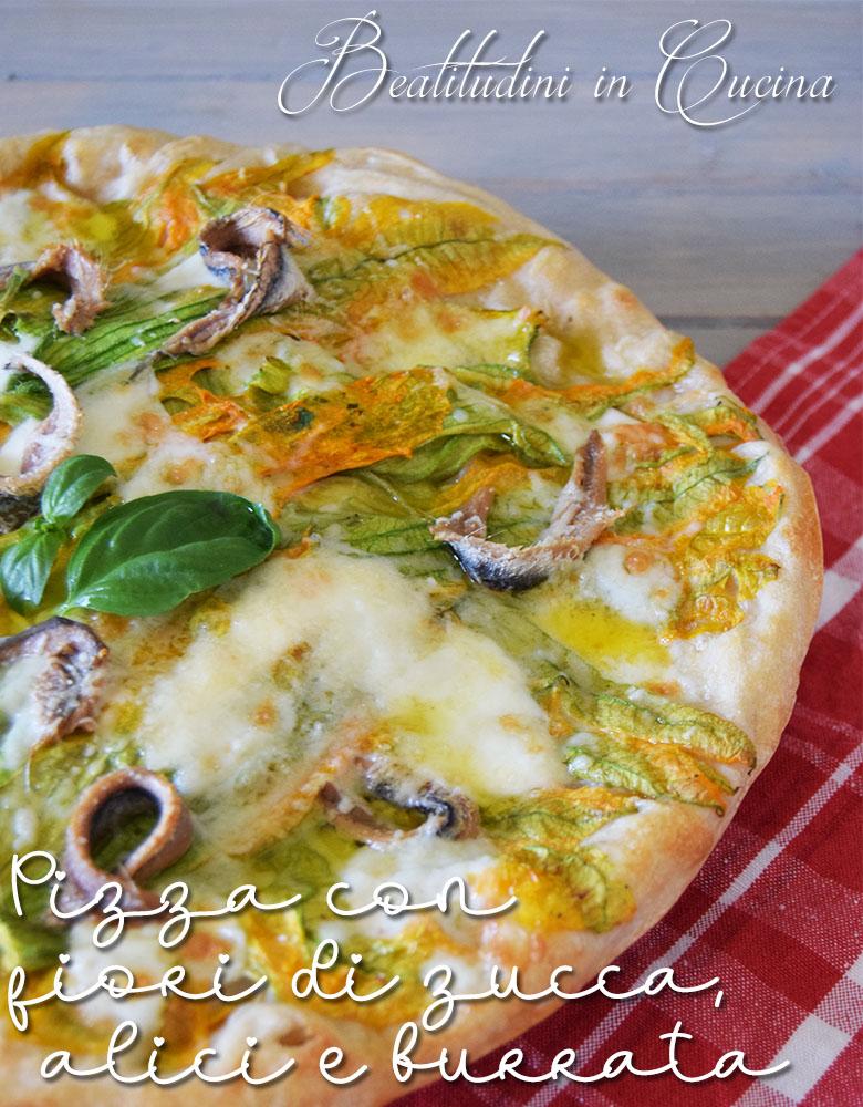 Pizza con fiori di zucca, alici e burrata